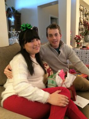 qualities / Cushing's Disease News / Kat and Logan sit on the couch with presents at Christmas.